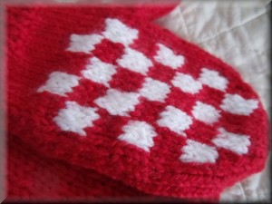 knitted red & white mittens